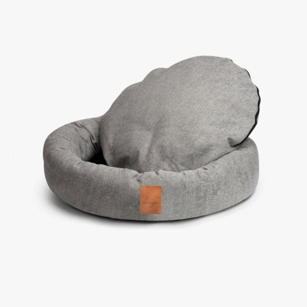 Ljusgrå rund hundbädd med läderdetalj framtill